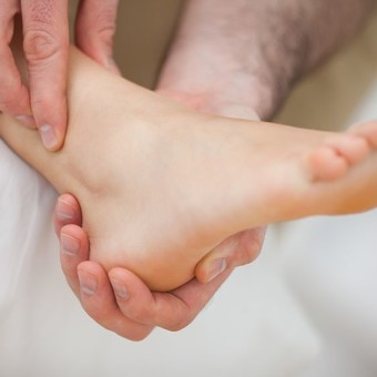 Orthopedic doctor examining a patient's foot and ankle